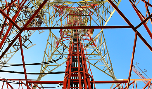 Image of the inside of a red and white lattice tower